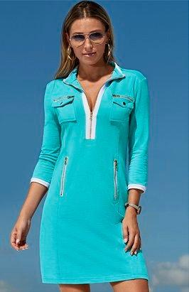 model wearing a light blue and white long-sleeve sport dress and sunglasses.