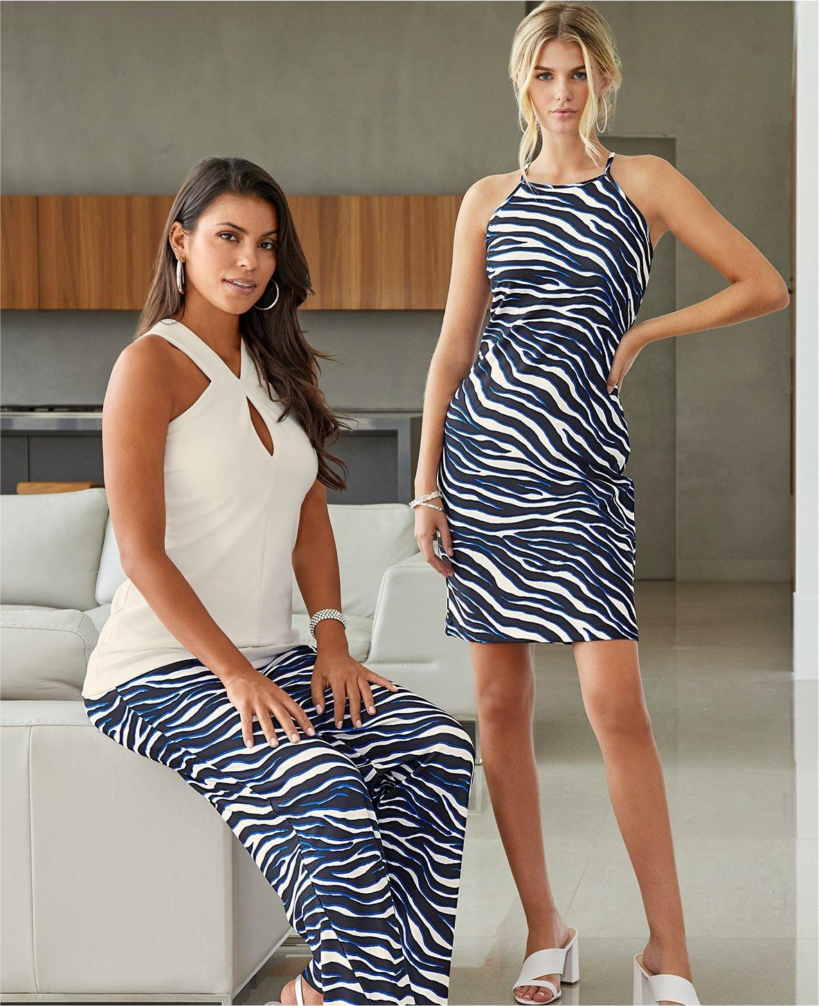left model wearing a white keyhole halter top and blue and white zebra striped palazzo pants. right model wearing a sleeveless blue and white zebra print dress.