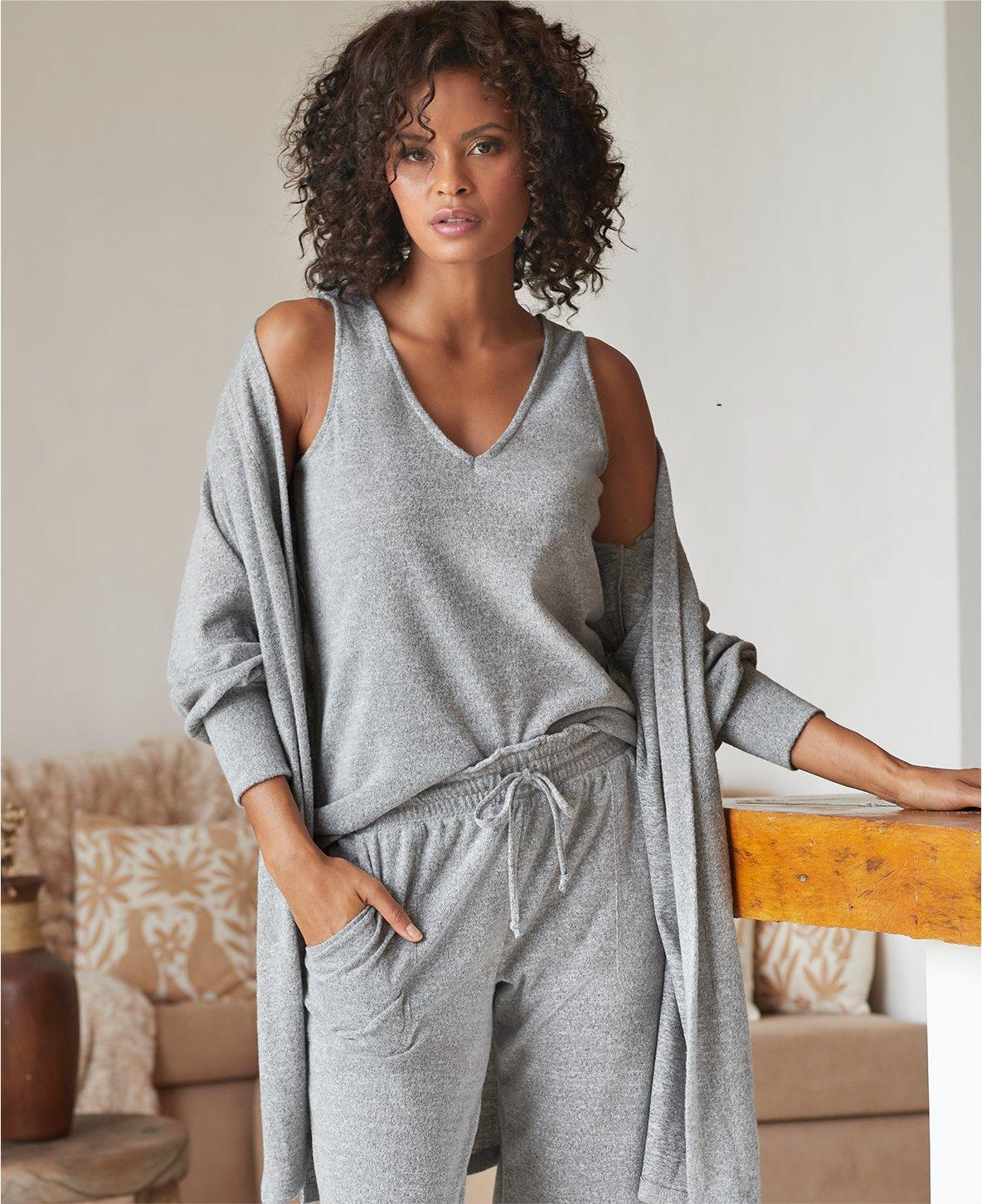 model wearing a gray tank top, gray duster, and gray sweatpants.