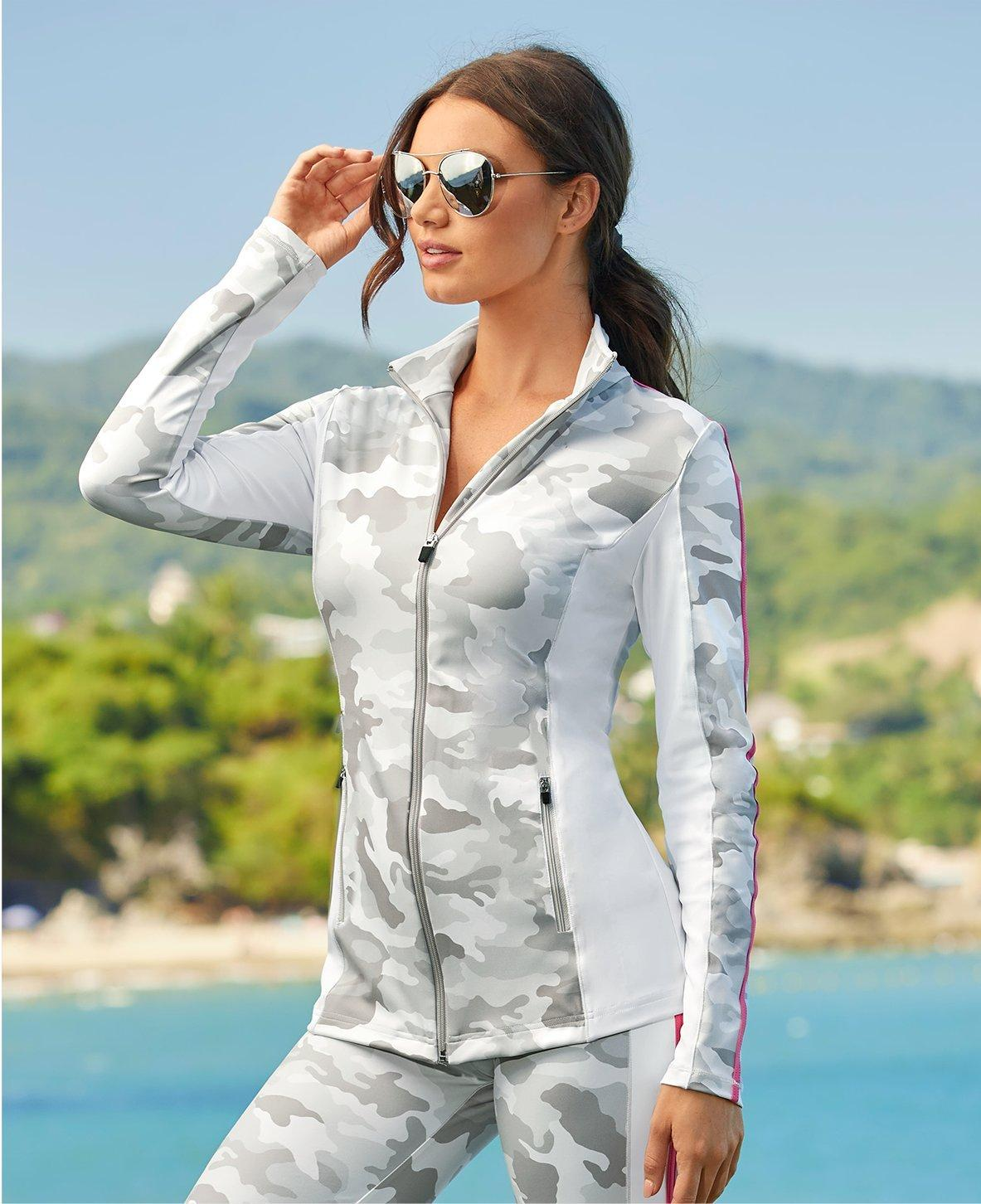 model wearing a gray camo print two-piece sport set and sunglasses.