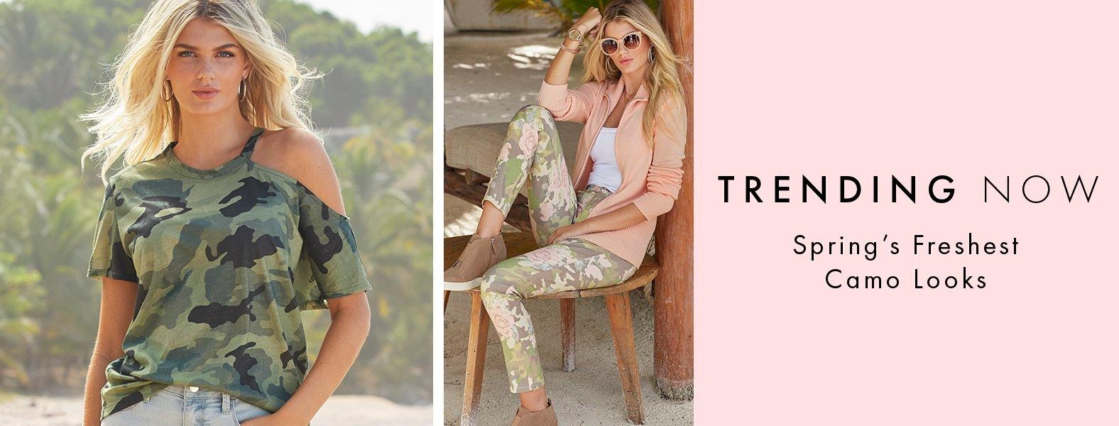 left model wearing a camo print off-the-shoulder top. right model wearing camo print pants, white tank top, and pink jacket.