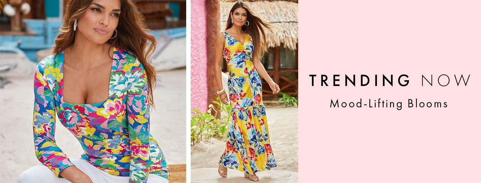 left model wearing a multicolored floral print three-quarter sleeve top. right model wearing a multicolored floral print sleeveless maxi dress.