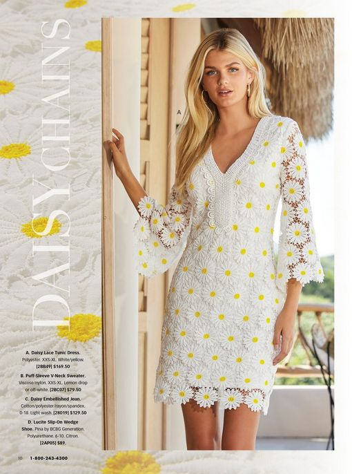 model wearing a white long-sleeve daisy embroidered sheath dress.