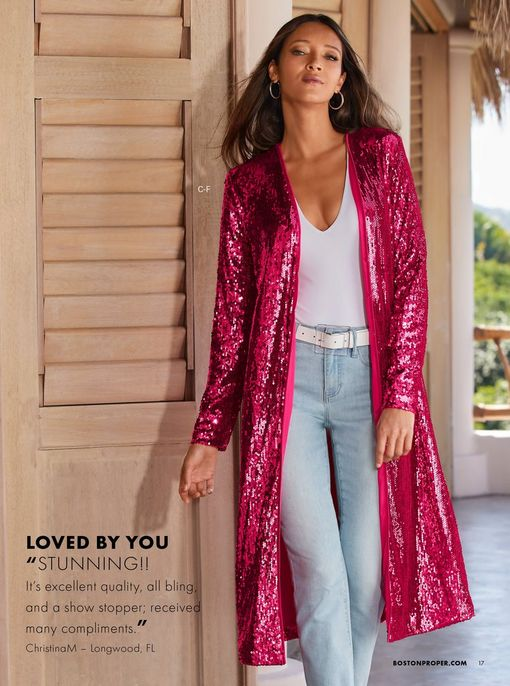 model wearing a bright pink sequin duster, white v-neck top, white belt, and light wash jeans.