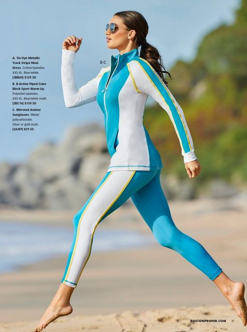 model wearing a white, blue, and yellow color block two-piece sport set and aviator sunglasses.