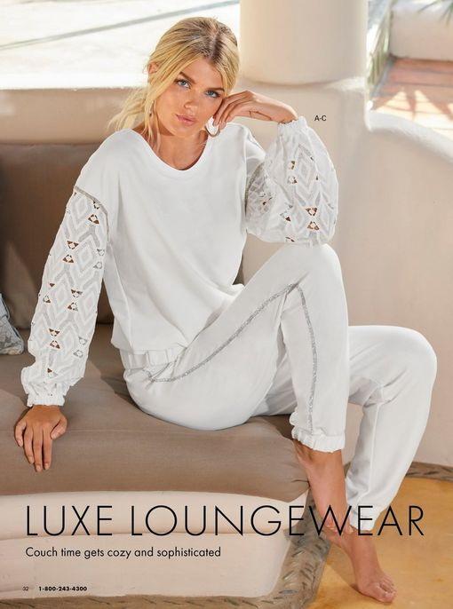 model wearing a white lace sweater and white sequin stripe joggers.