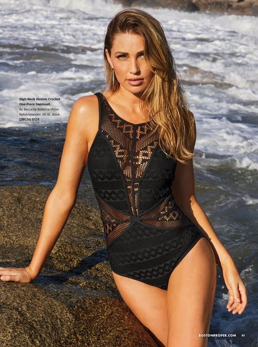 model wearing a black mesh and swiss dot one-piece swimsuit.