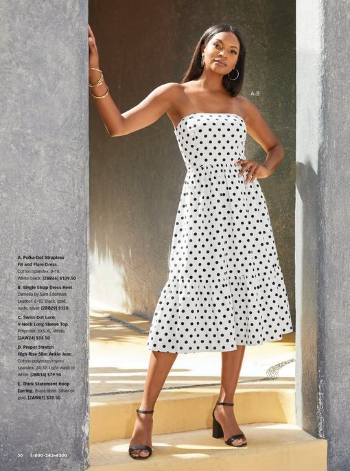 model wearing a strapless black and white polka dot midi dress and black single strap heels.