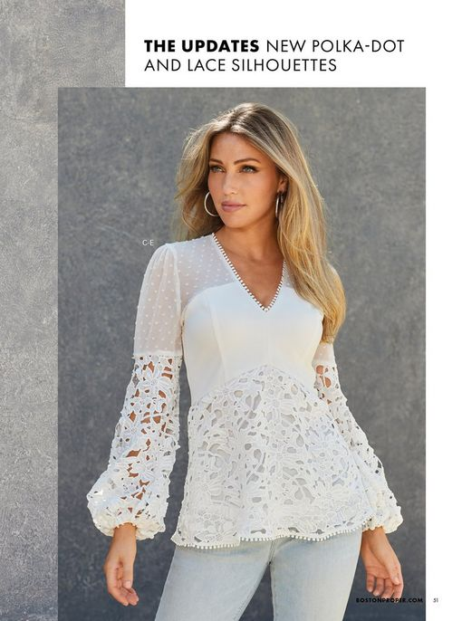model wearing a white long-sleeve lace and swiss dot top and light wash jeans.