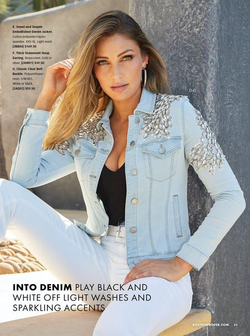 model wearing a jewel and sequin embellished light wash denim jacket, black tank top, white belt, white jeans, and silver hoop earrings.