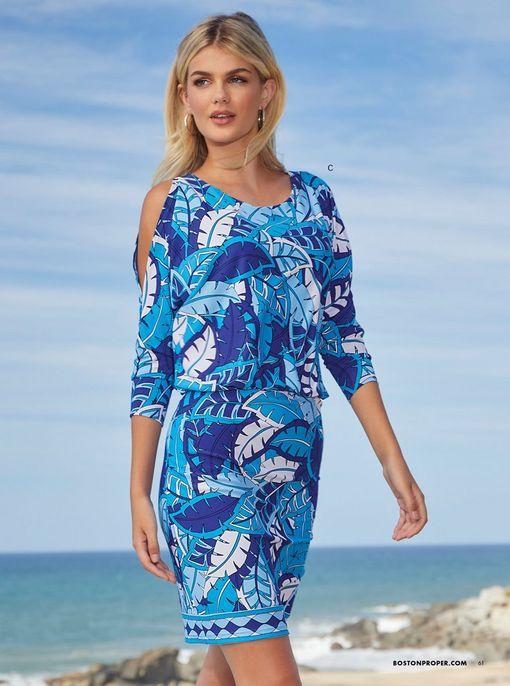 model wearing a blue rainforest print long-sleeve dress.