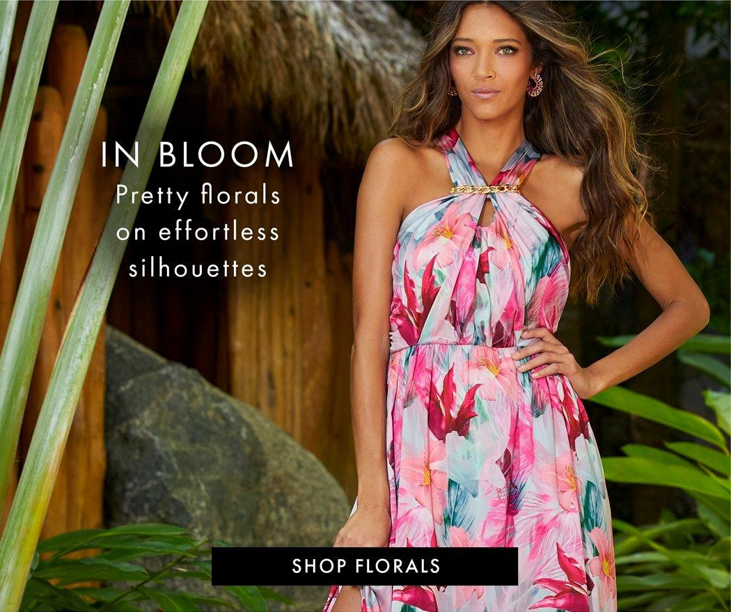 model wearing a multicolored halter neck floral print dress.