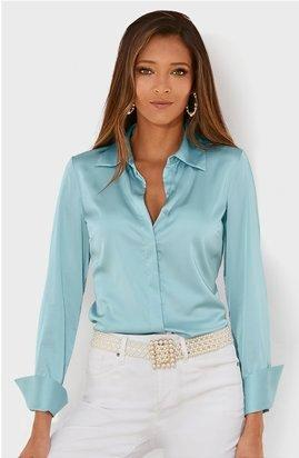 model wearing a light blue charm long sleeve button down shirt, pearl belt, and white jeans.