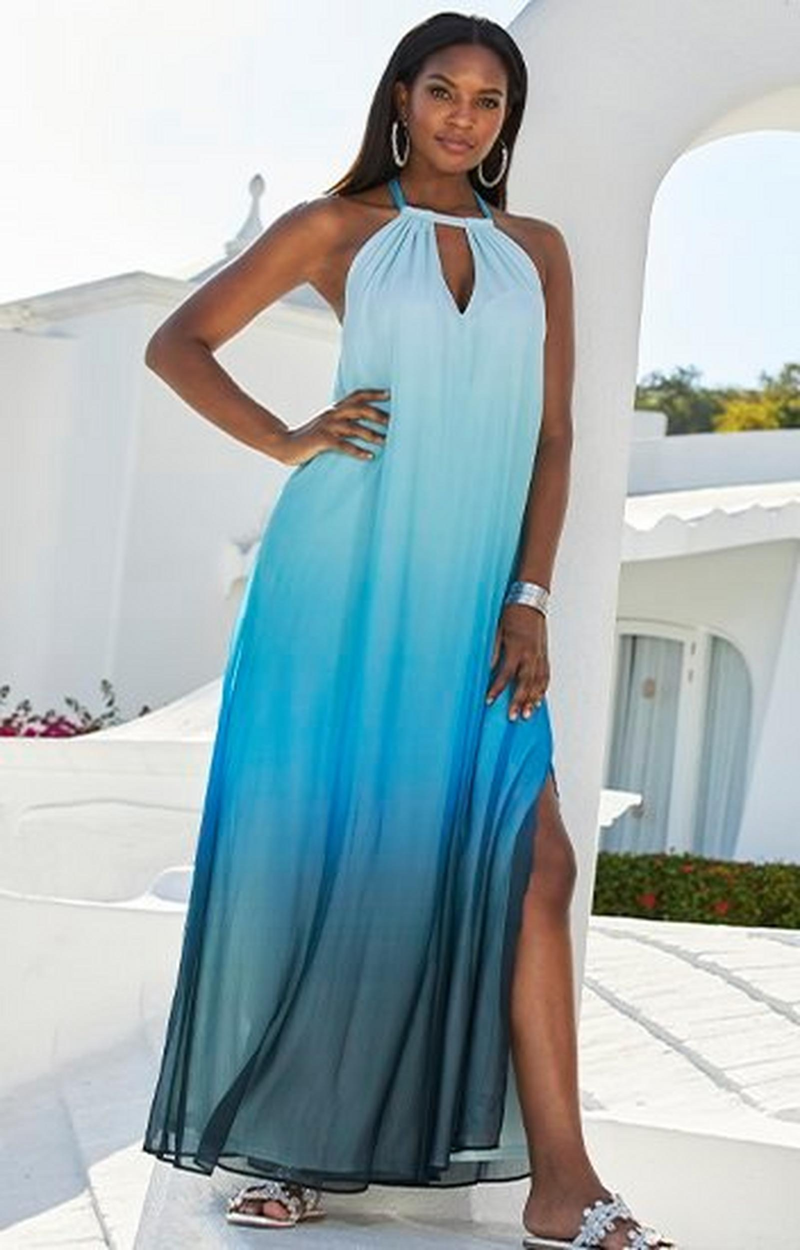 model wearing a blue ombre maxi dress with a halter neckline and silver crystal embellished sandals.