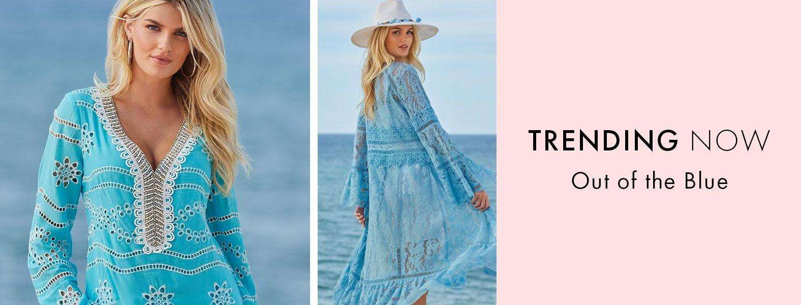 left model wearing a blue eyelet tunic with silver embellishments. right model wearing a light blue lace duster and a white floppy hat with turquoise embroidery.