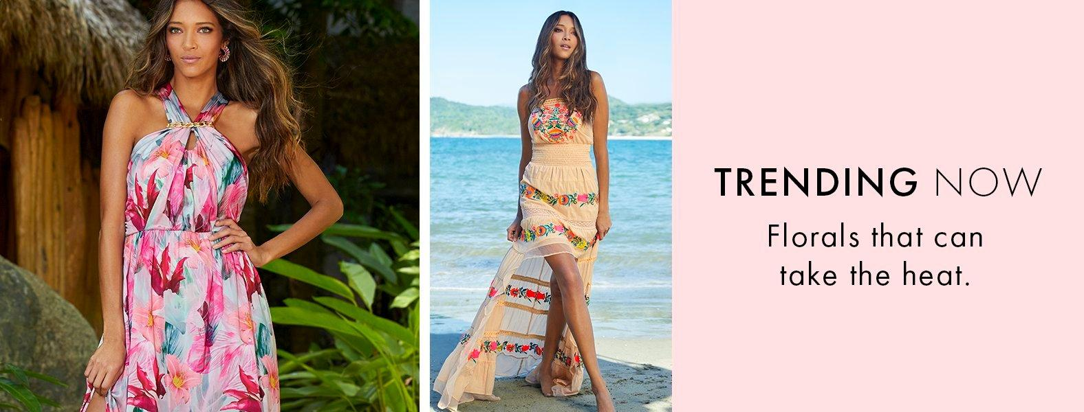 left model wearing a pink and blue floral print halter neck maxi dress. right model wearing a strapless tan high-low maxi dress with bright floral embroidery.