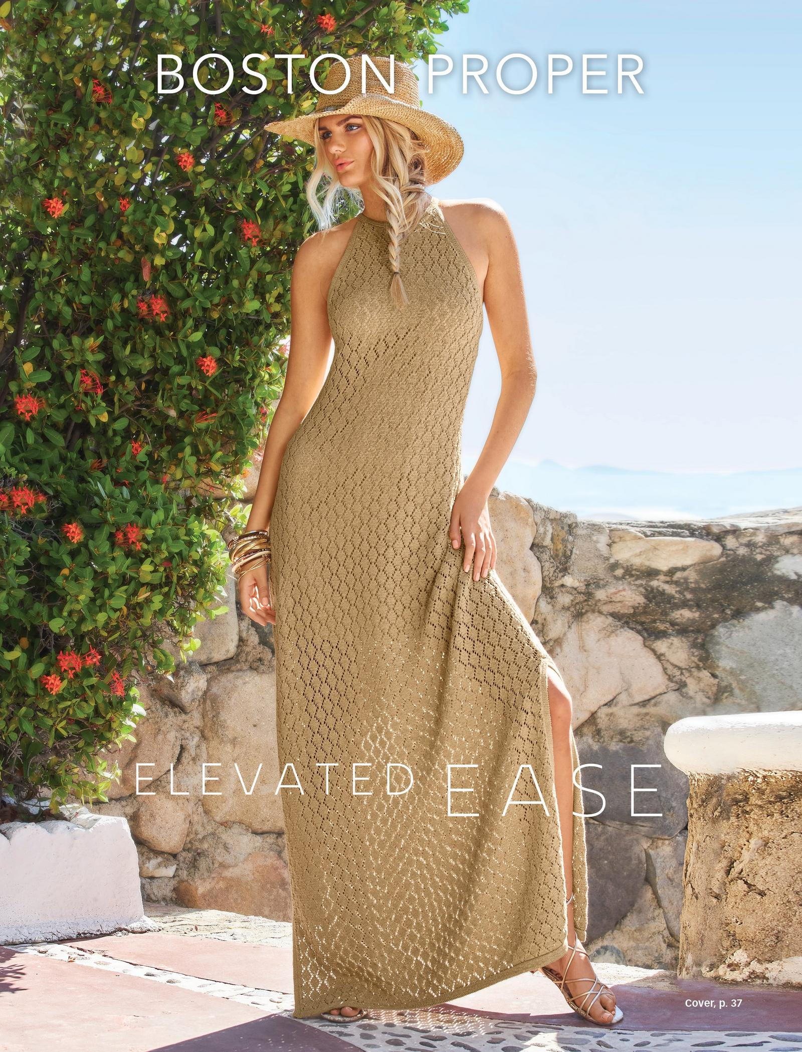 model wearing a tan high-neck sleeveless crochet maxi dress, straw hat, and silver strappy sandals.