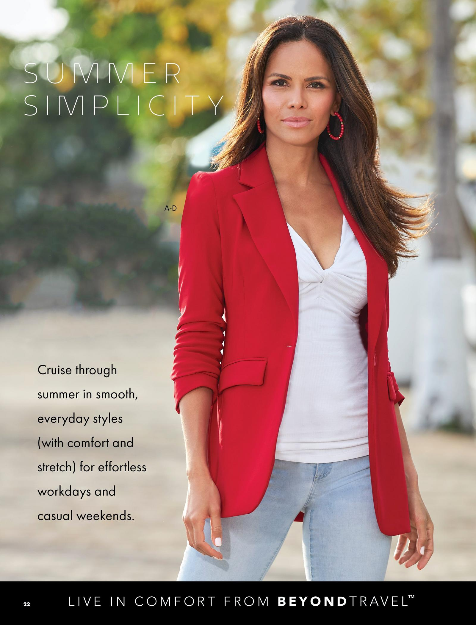 model wearing a red blazer, white ribbed twist-front top, red hoop earrings, and light wash jeans.