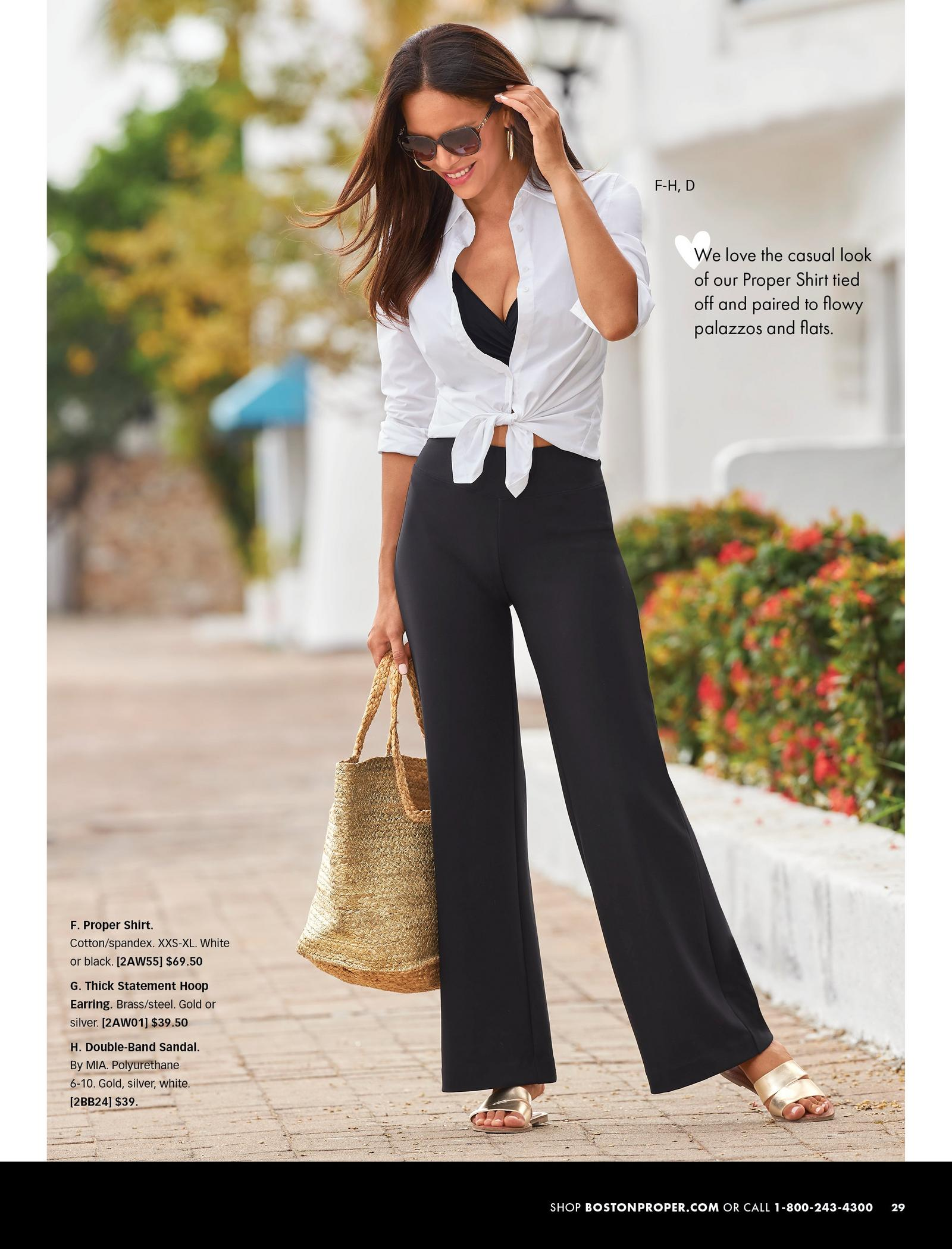 model wearing a white button-down top that has been tied at the front, black bathing suit top, black pants, gold strappy sandals, gold hoop earrings, sunglasses, and holding a straw bag.