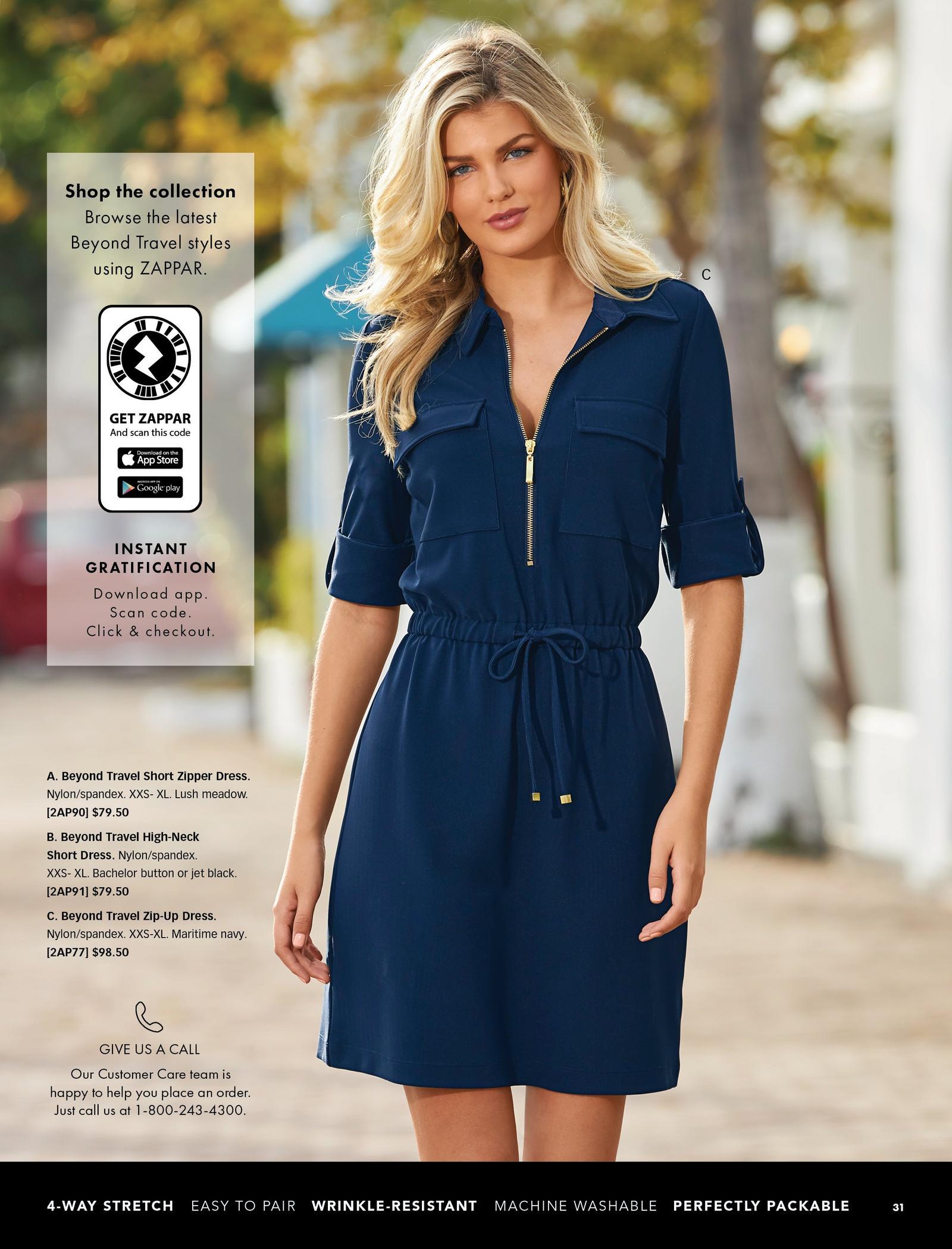 model wearing a navy zip-up tie-waist dress.