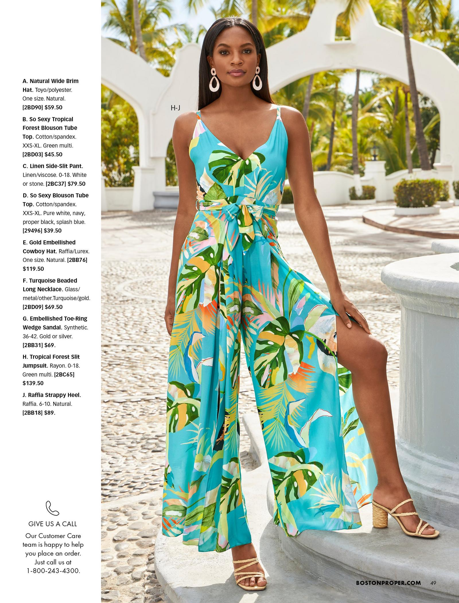model wearing a tropical print side-slit sleeveless jumpsuit with a tie-waist and raffia strappy heels.