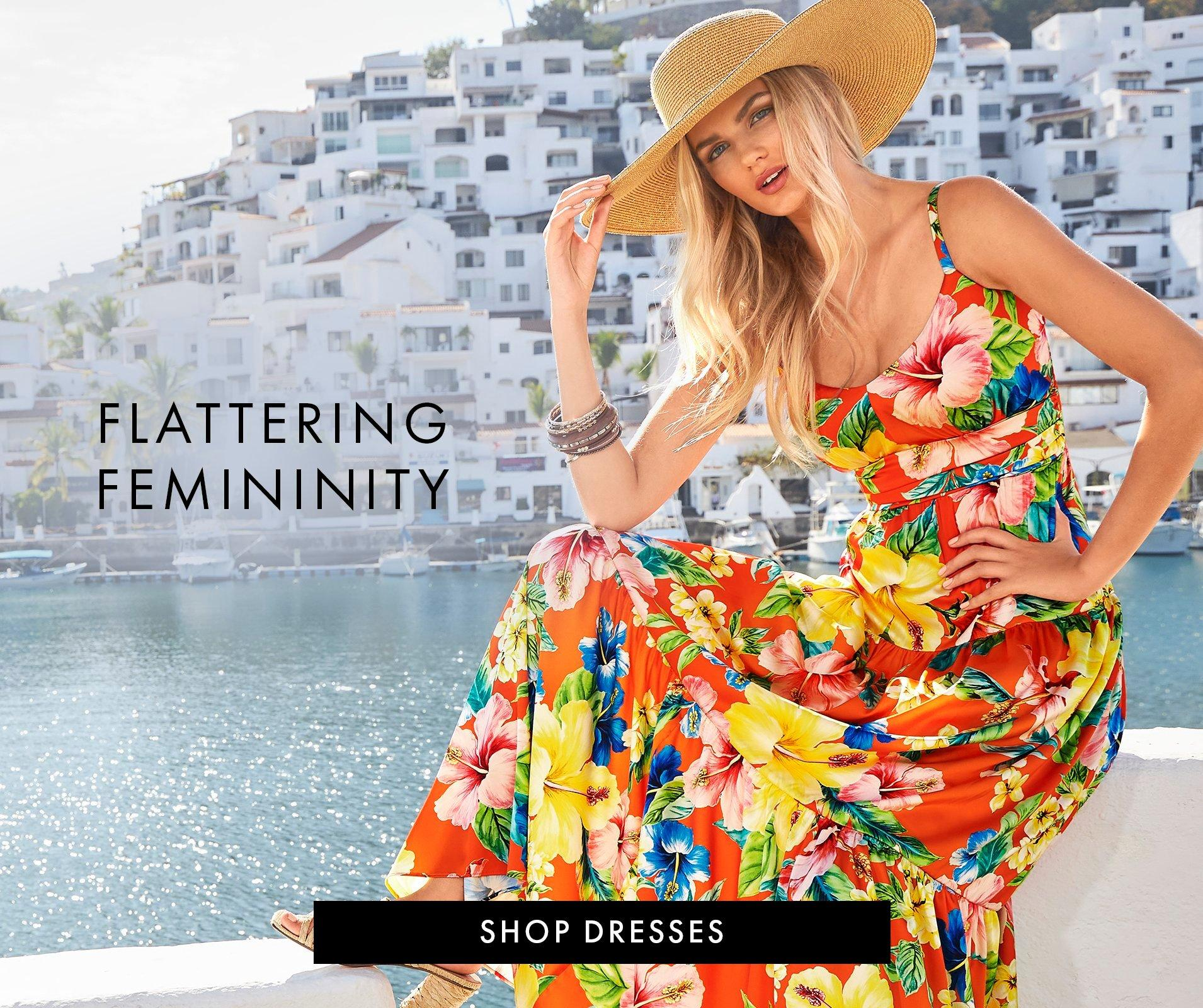 model wearing a red and multicolored flower printed sleeveless maxi dress and a straw hat.
