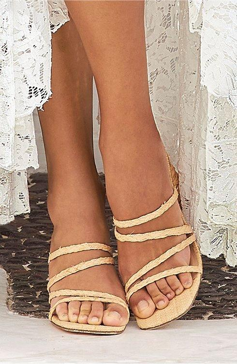 model wearing raffia strapped sandle.