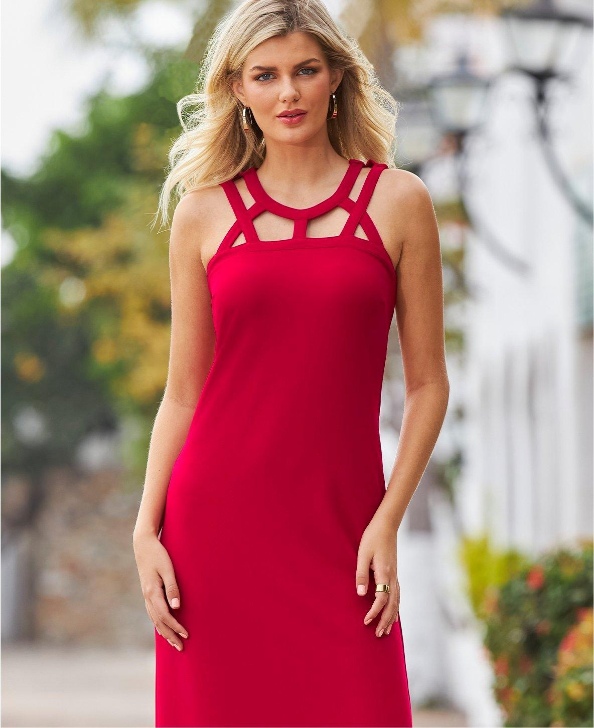 model wearing a red cutout sleeveless dress and gold hoop earrings.