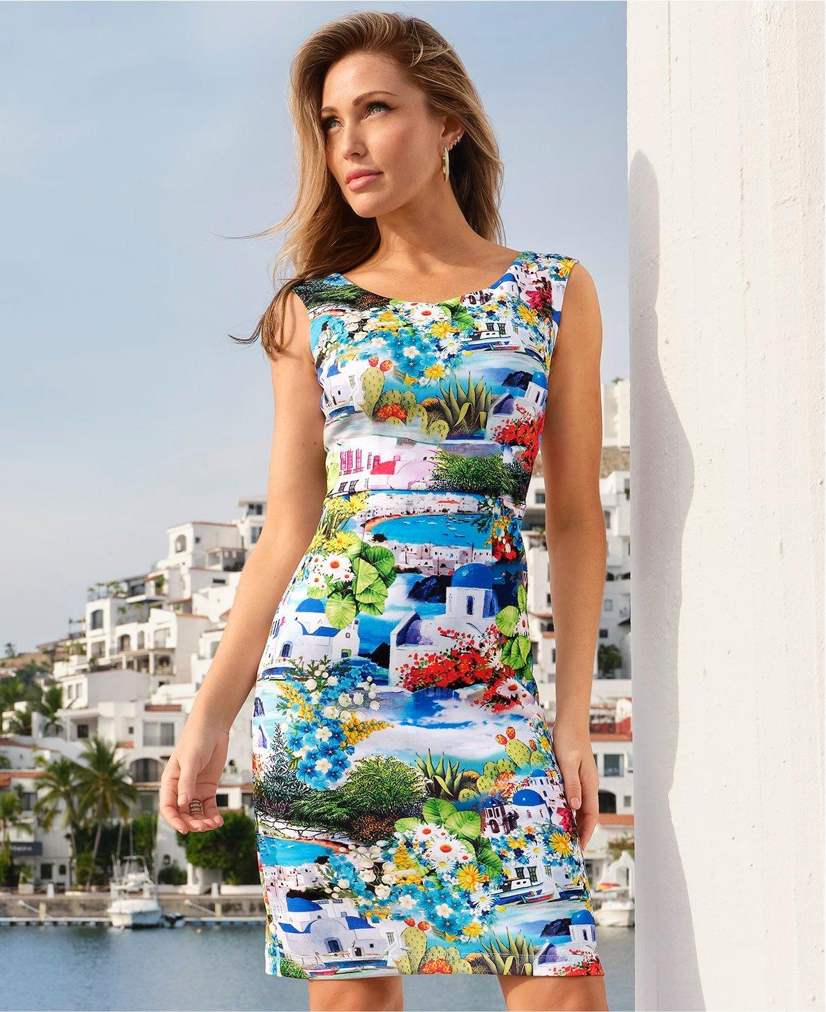 model wearing a multicolored printed sleeveless sheath dress.