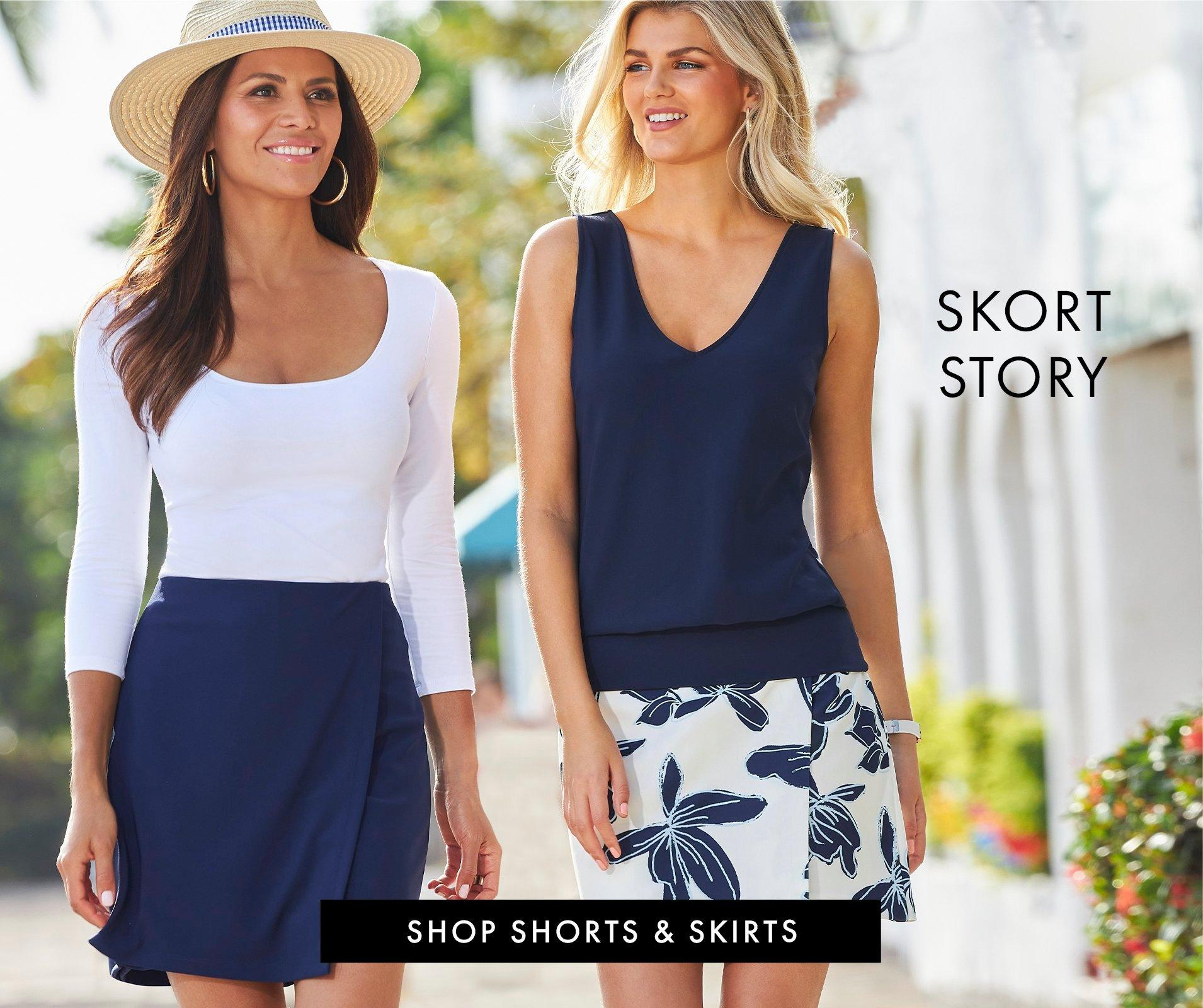 Left model wearing a white three-quarter sleeve top, navy skort, and straw hat. right model wearing a navy sleeveless blouson top and a blue and white floral print skort.