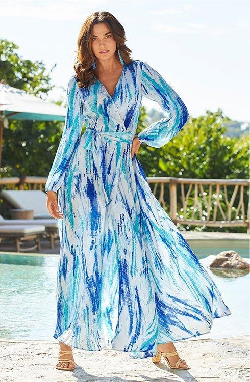 model wearing a blue tie-dye wrap dress.