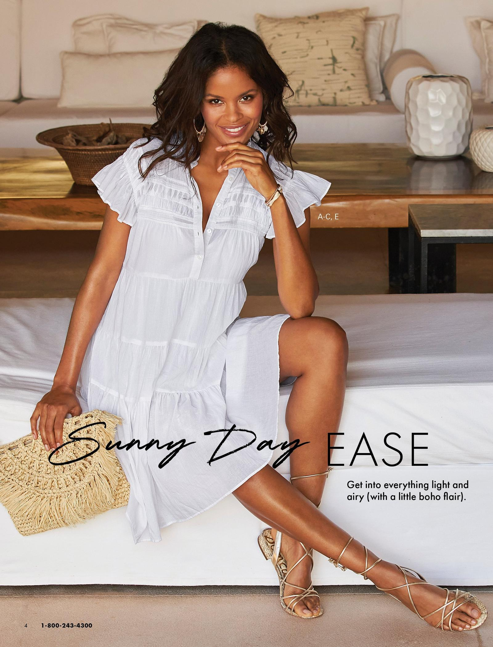 model wearing a white tiered shift dress, gold embellished hoop earrings, gold lace-up sandals, and holding a straw clutch.