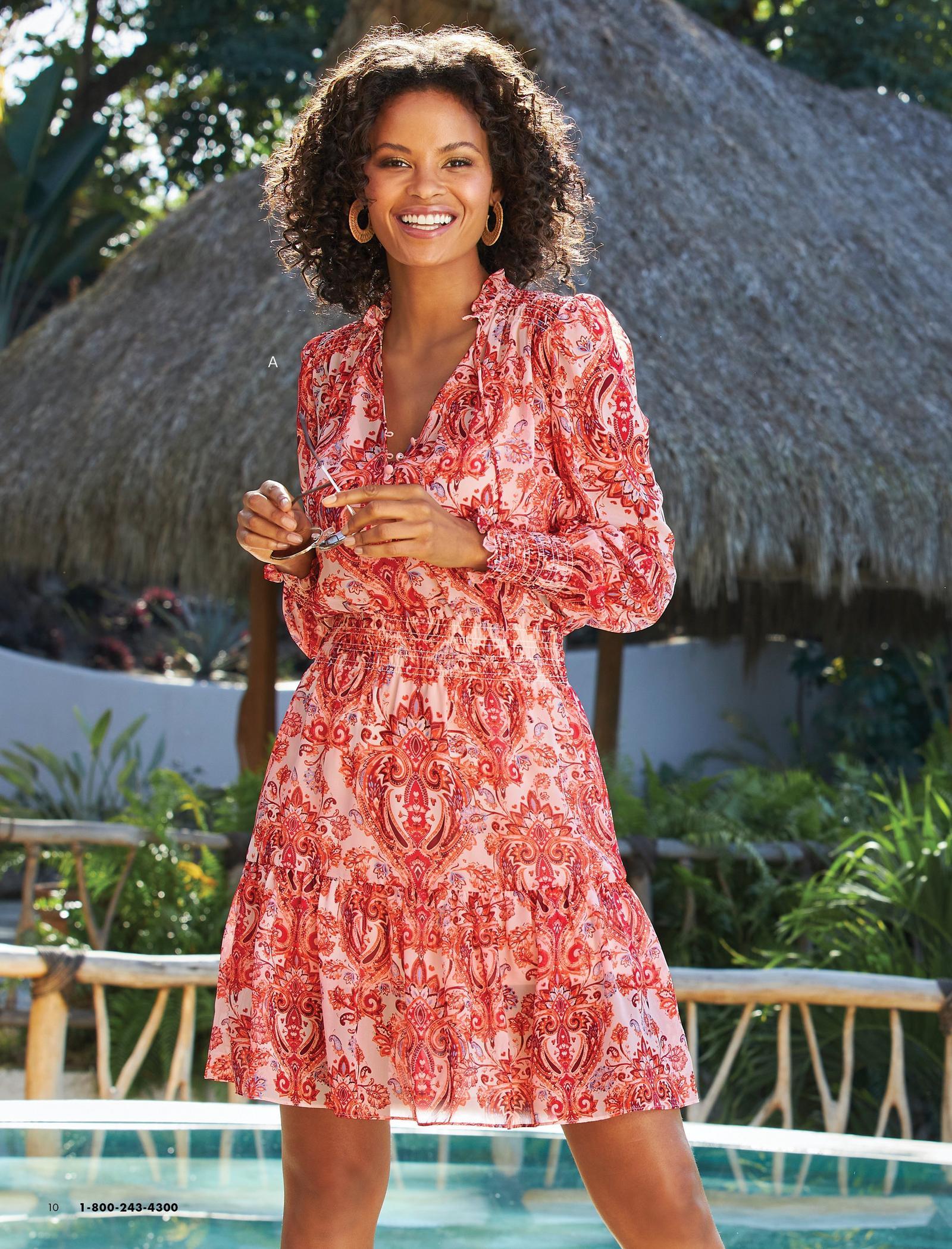 model wearing a pink boho printed long-sleeve smocked dress.