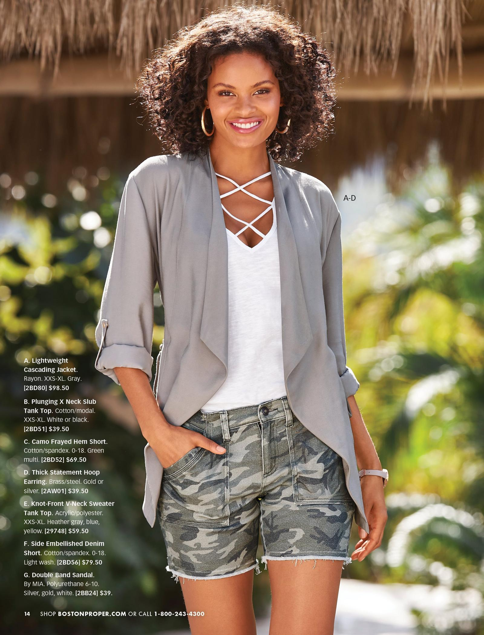 model wearing a gray light-weight jacket, white x neck slub tank top, camo printed denim shorts, and gold hoop earrings.
