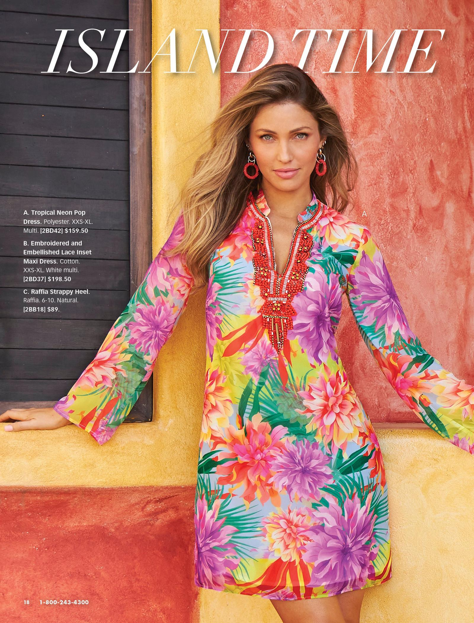 model wearing a multicolored tropical print beaded long-sleeve shift dress and red and white hoop earrings.