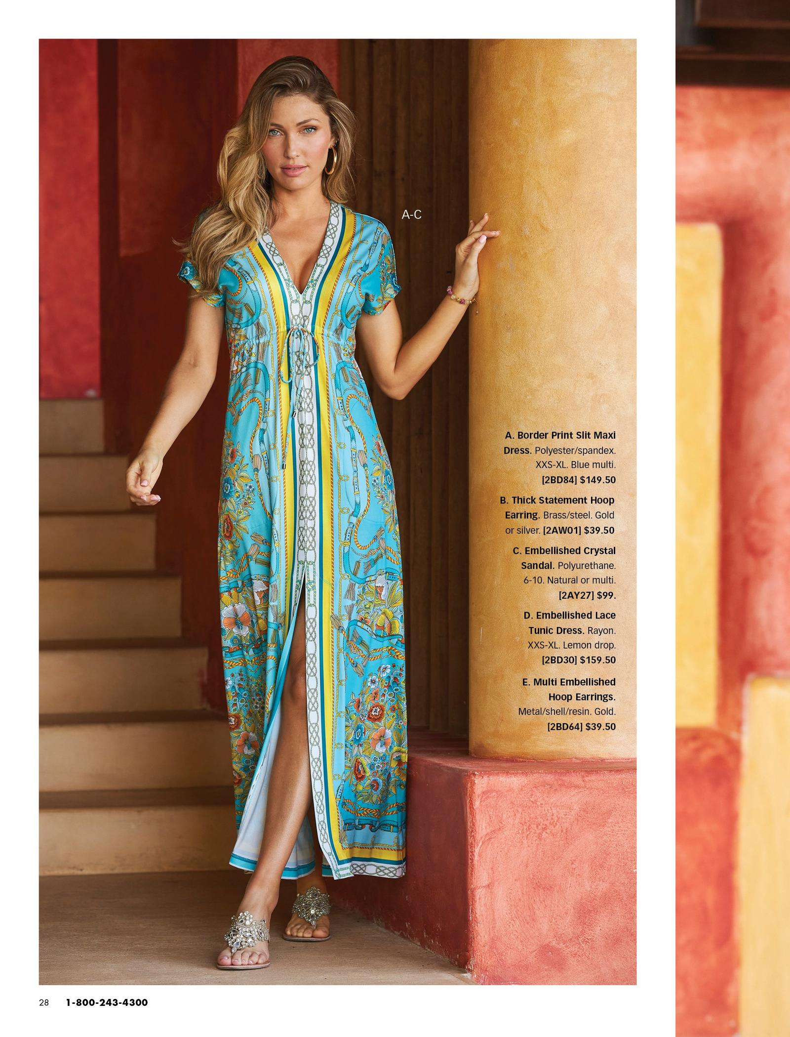 model wearing a blue border print slit maxi dress, gold hoop earrings, and silver crystal embellished sandals.