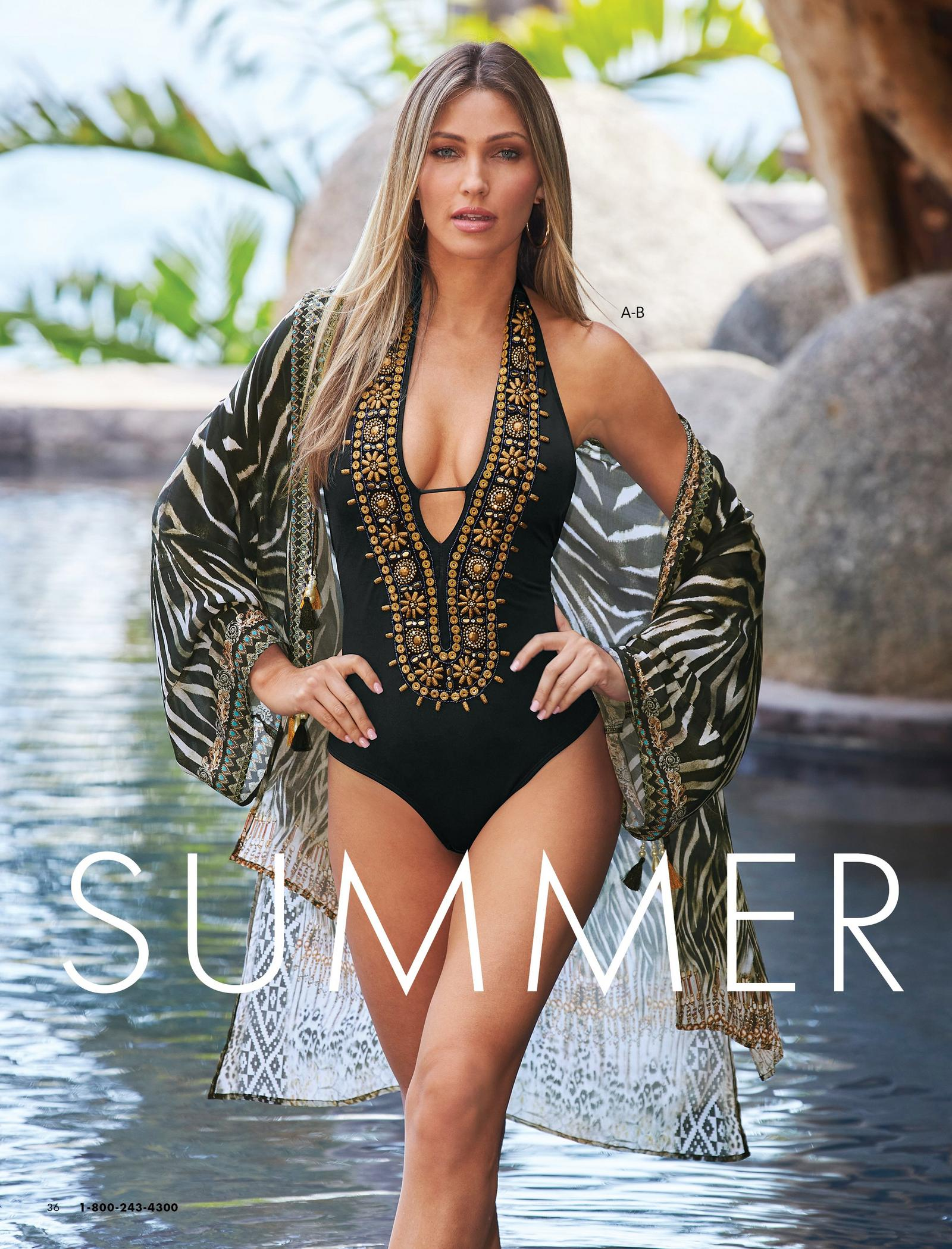 model wearing a black and gold embellished deep v-neck one-piece swimsuit and a gold and black animal print duster.