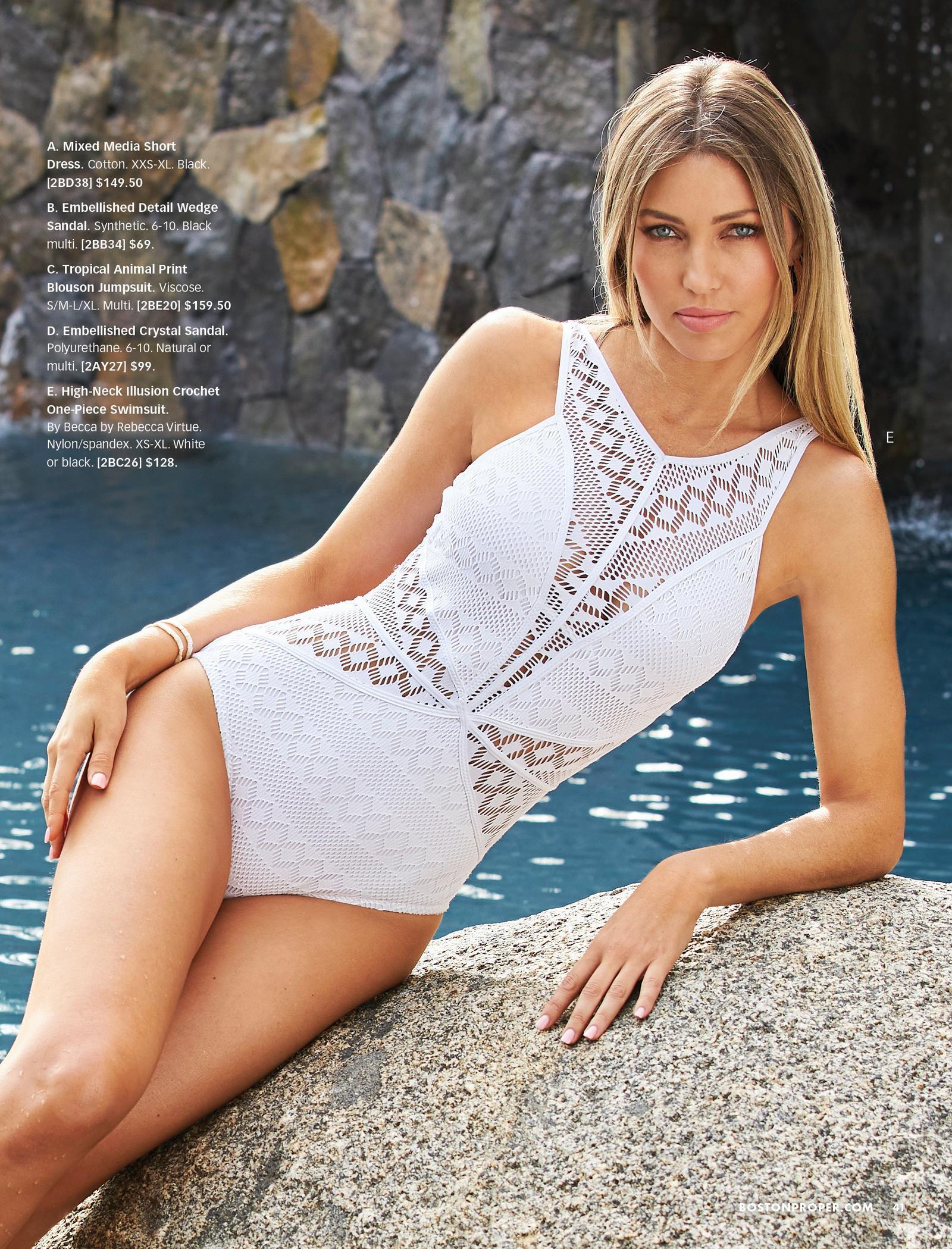 model wearing a white crochet high-neck one-piece swimsuit.