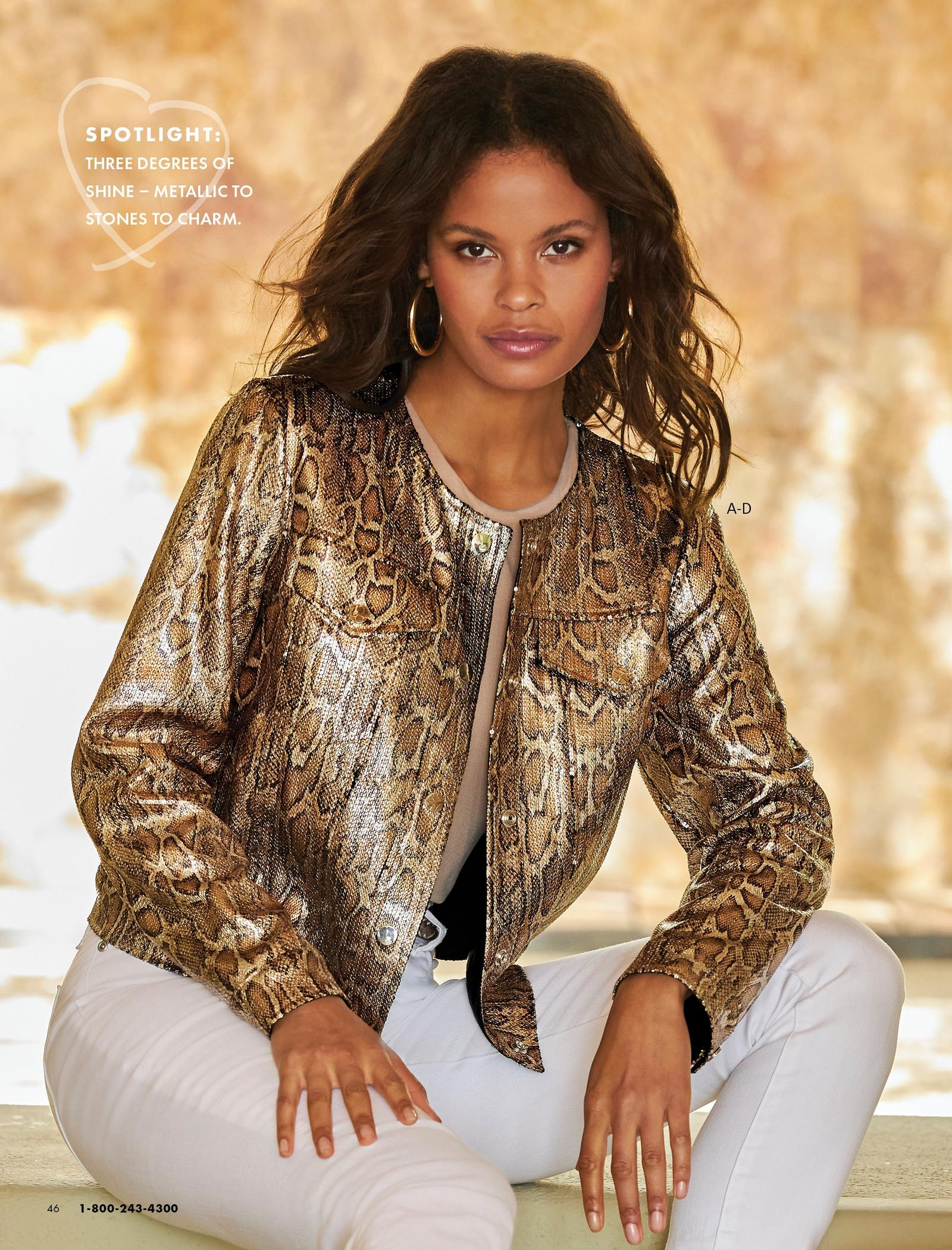 model wearing a gold metallic snake print jacket, tan top, gold hoop earrings, and white jeans.
