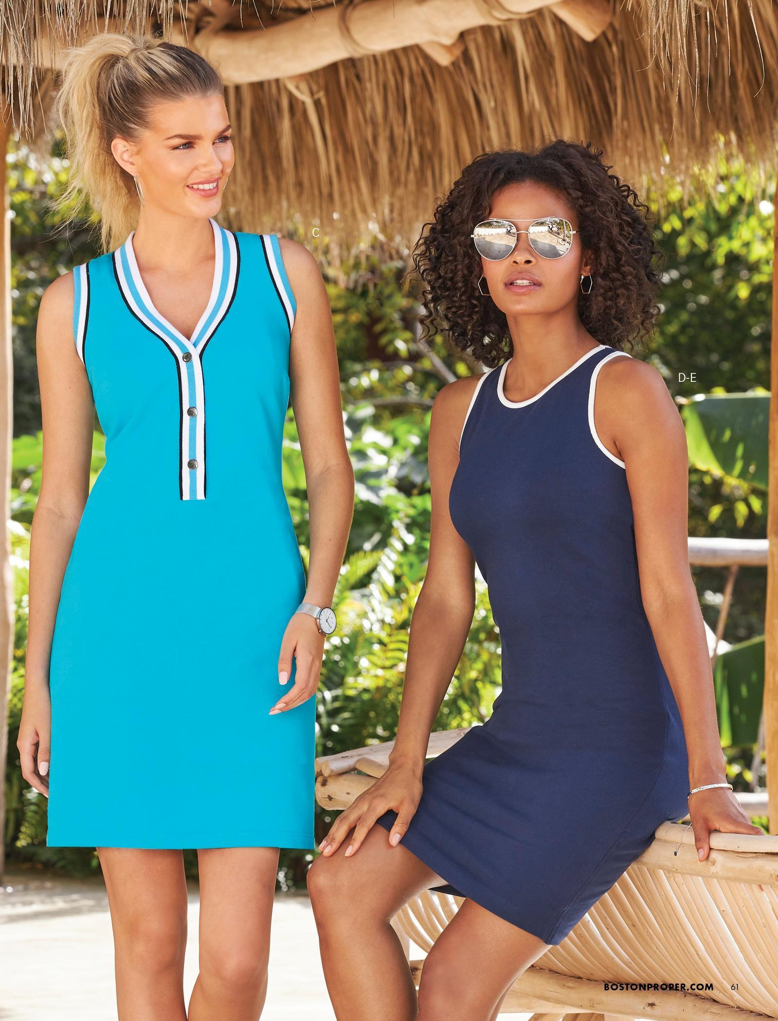 left model wearing a light blue sleeveless sport dress. right model wearing a high-neck sleeveless navy sport dress and sunglasses.
