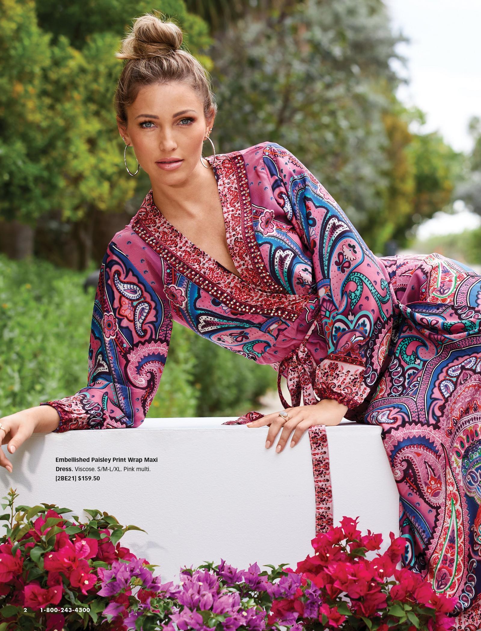 model wearing a multicolored paisley print long-sleeve maxi wrap dress.