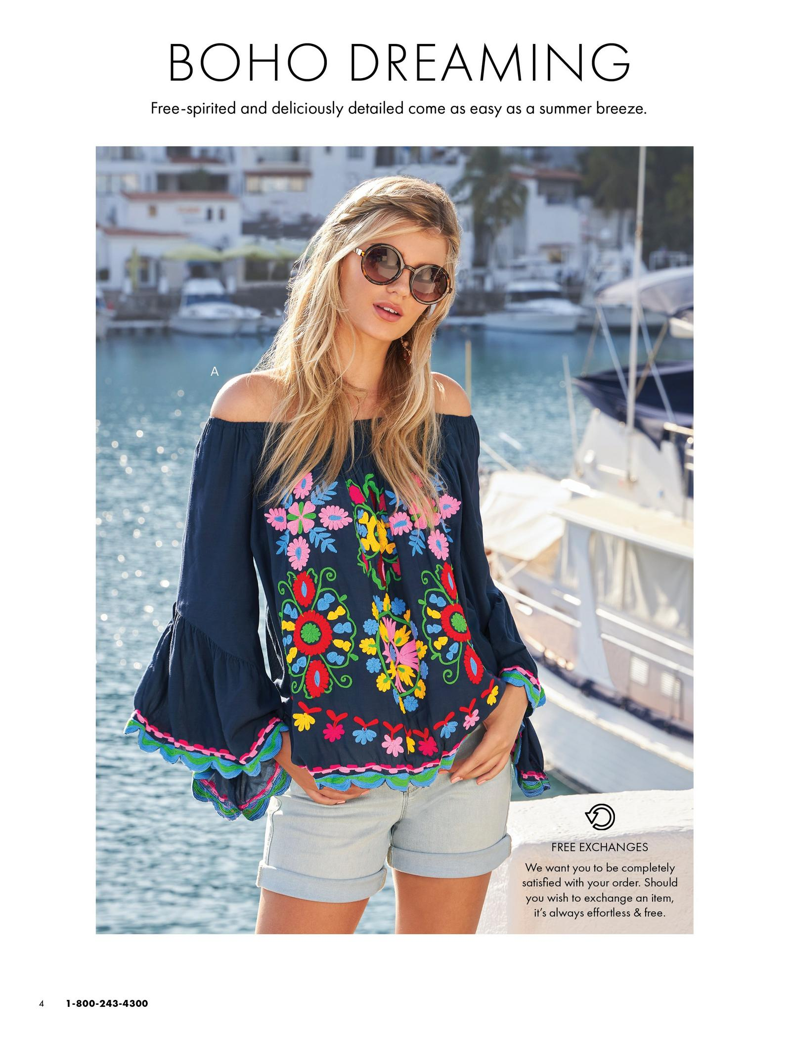 model wearing a navy off-the-shoulder bell-sleeve boho top with floral embroidery, denim shorts, and sunglasses.