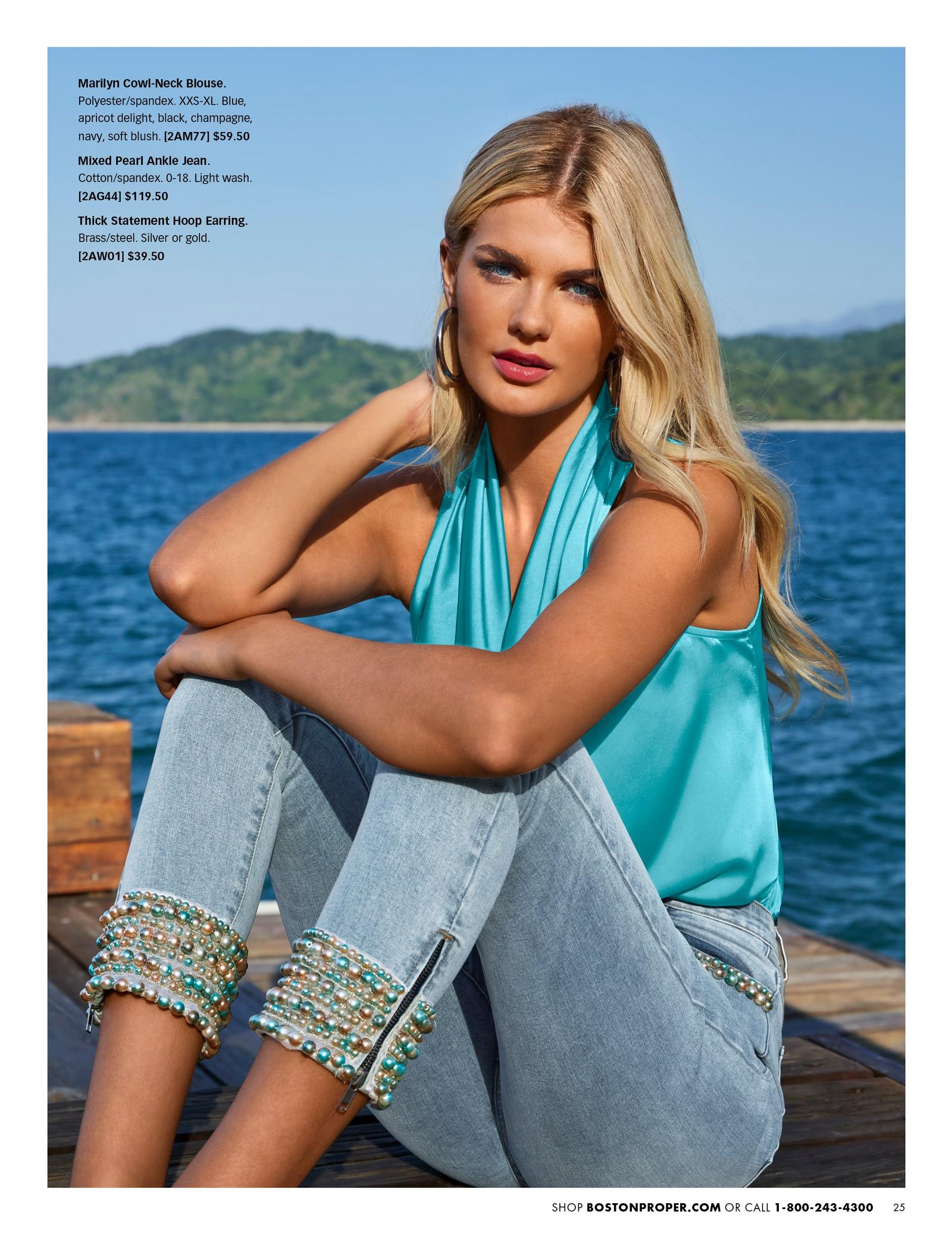 model wearing a light blue sleeveless cowl neck blouse and jewel embellished ankle jeans.