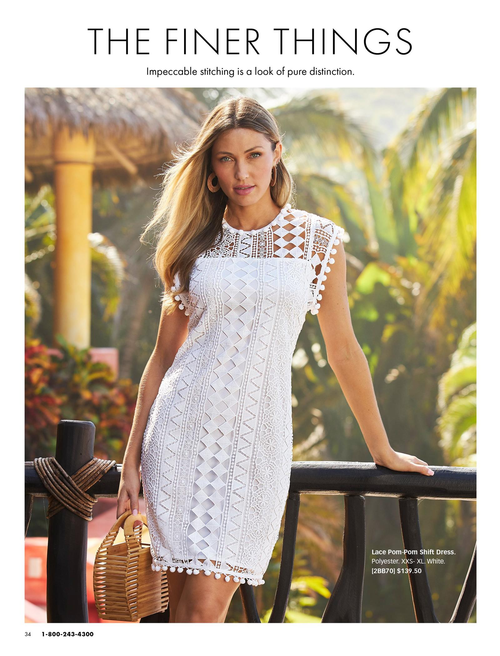 model wearing a white lace pom-pom shift dress.
