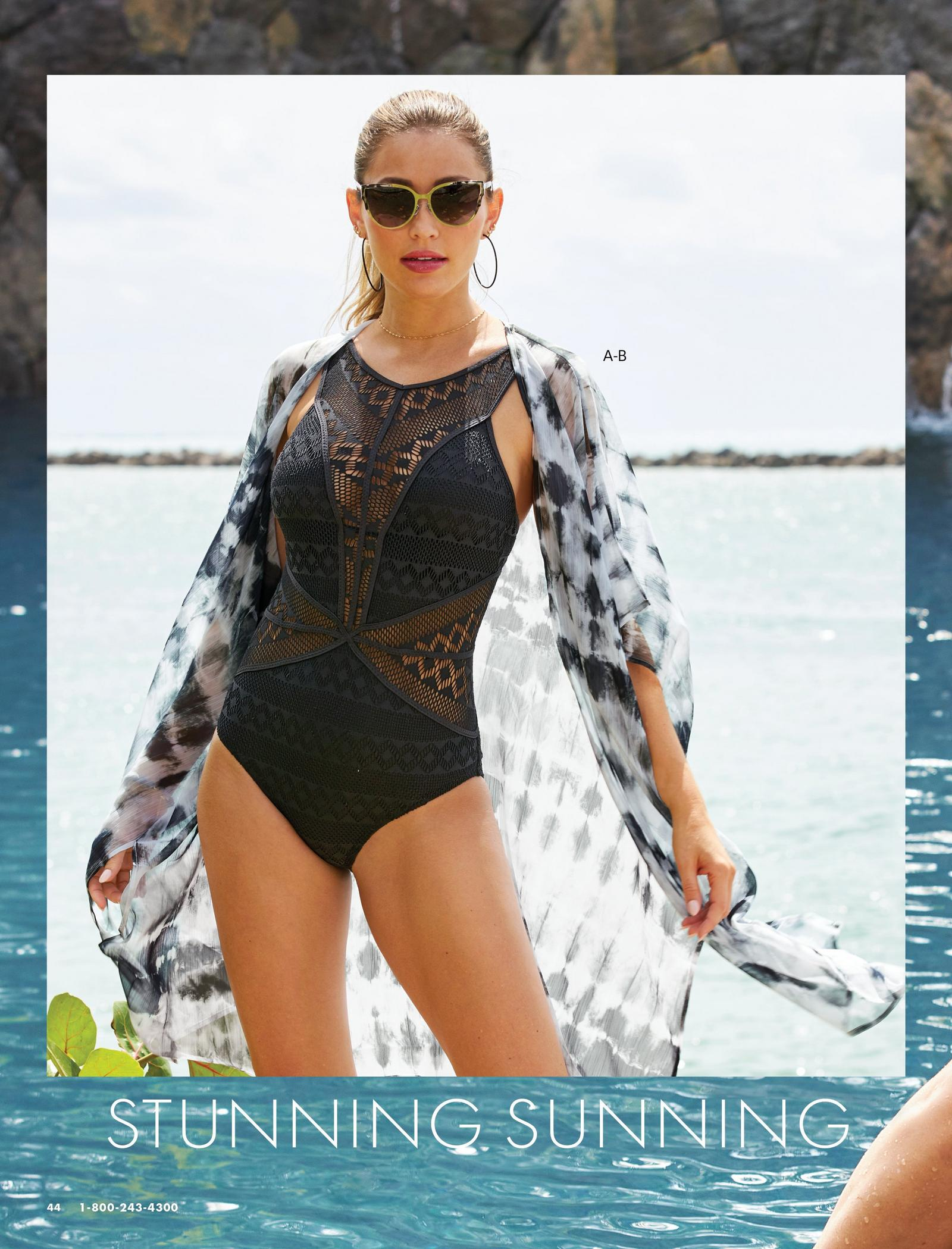 model wearing a black crochet one-piece swimsuit, black and white tie-dye duster cover-up, and sunglasses.