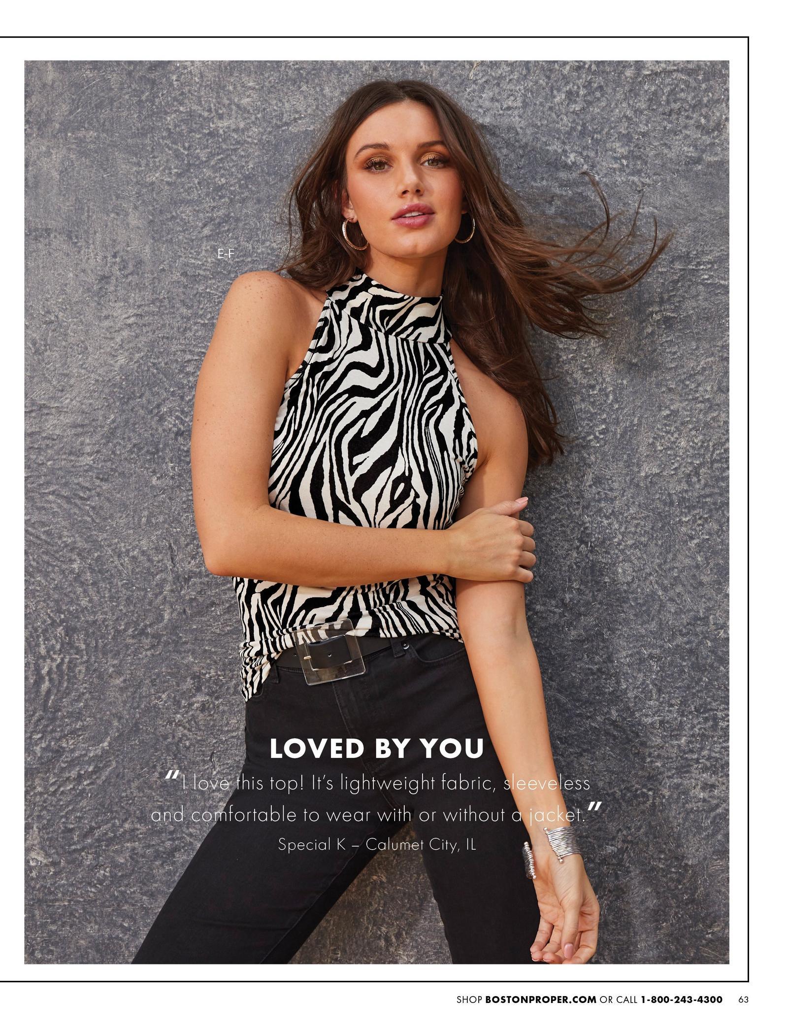 model wearing a black and white zebra print high-neck sleeveless top, black belt, and black jeans.