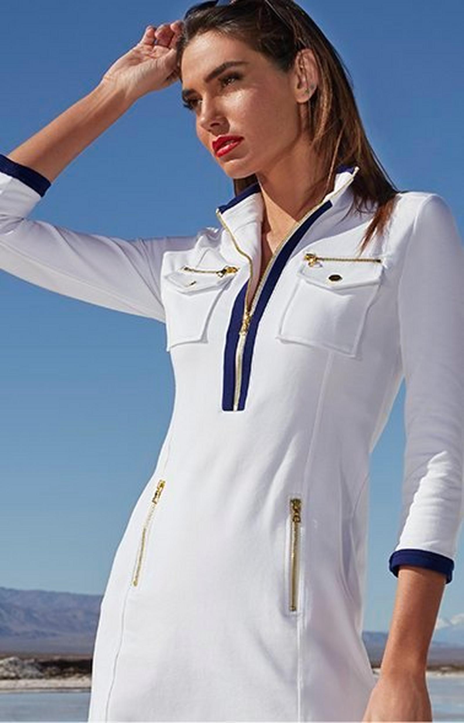 model wearing a white long-sleeve chic zip sport dress.
