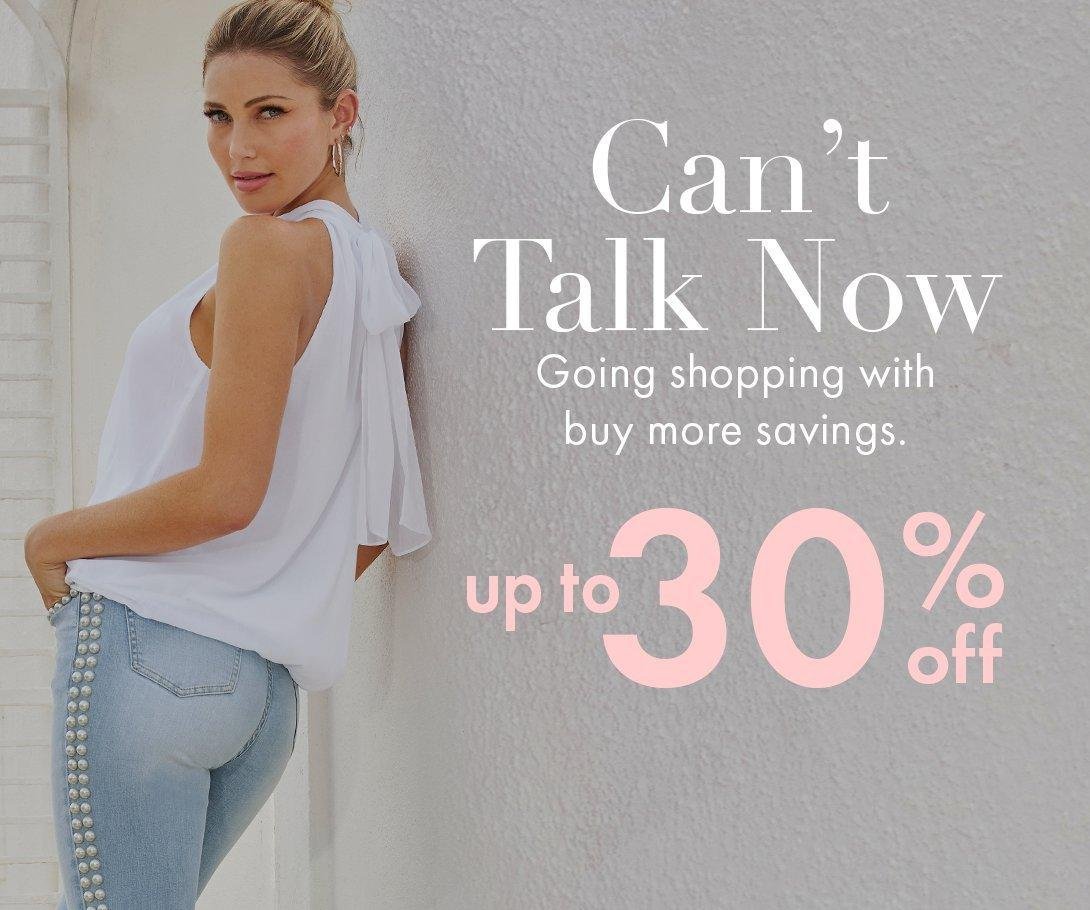 left model leaning against the wall wearing a white mock-neck chiffon sleeveless top and pearl studded jeans. white and pink text overlay explaining the sale.