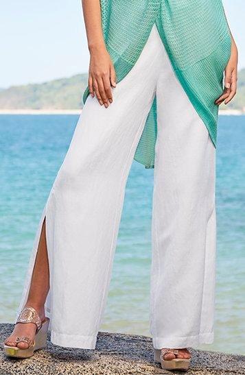 model wearing white side-slit linen pants.