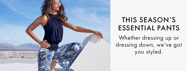 model wearing a navy mock-neck blouson sleeveless top and blue tile print palazzo pants.